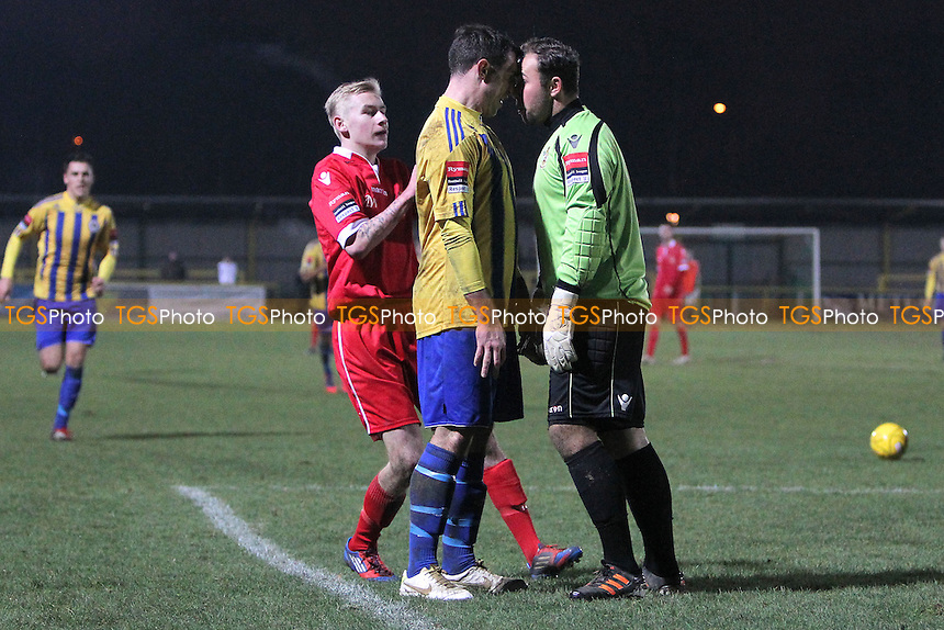 Nick Reynolds of Romford squares up to Aveley goalkeeper Jake Giddens - Romford vs Aveley - Ryman League Division One North Football at Ship Lane, Thurrock FC - 08/12/12 - MANDATORY CREDIT: Gavin Ellis/TGSPHOTO - Self billing applies where appropriate - 0845 094 6026 - contact@tgsphoto.co.uk - NO UNPAID USE.