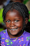"This girl participates in a care center for orphans and other vulnerable children in Chidyamanga, a village in southern Malawi that has been hard hit by drought in recent years, leading to chronic food insecurity, especially during the ""hunger season,"" when farmers are waiting for the harvest. The ACT Alliance is working with farmers in this village to switch to alternative, drought-resistant crops, as well as using irrigation and other improved techniques to increase agricultural yields. In Chidyamanga, residents have set aside a section of farmland where they work together to grow food especially for the orphans--many of whom lost their parents to AIDS--and other children in the center. Three times a week, the children come to the center, sing and play and eat a nutritious meal."