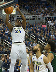 Nevada's Jordan Caroline dunks the ball against Colorado State in the second half of an NCAA college basketball game in Reno, Nev., Sunday, Feb. 25, 2018. (AP Photo/Tom R. Smedes)