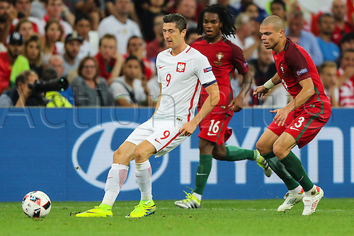 30.06.2016. Marseille, France. UEFA EURO 2016 quarter final match between Poland and Portugal at the Stade Velodrome in Marseille, France, 30 June 2016.   Robert Lewandowski (POL), Renato Sanches (POR), Pepe (POR)