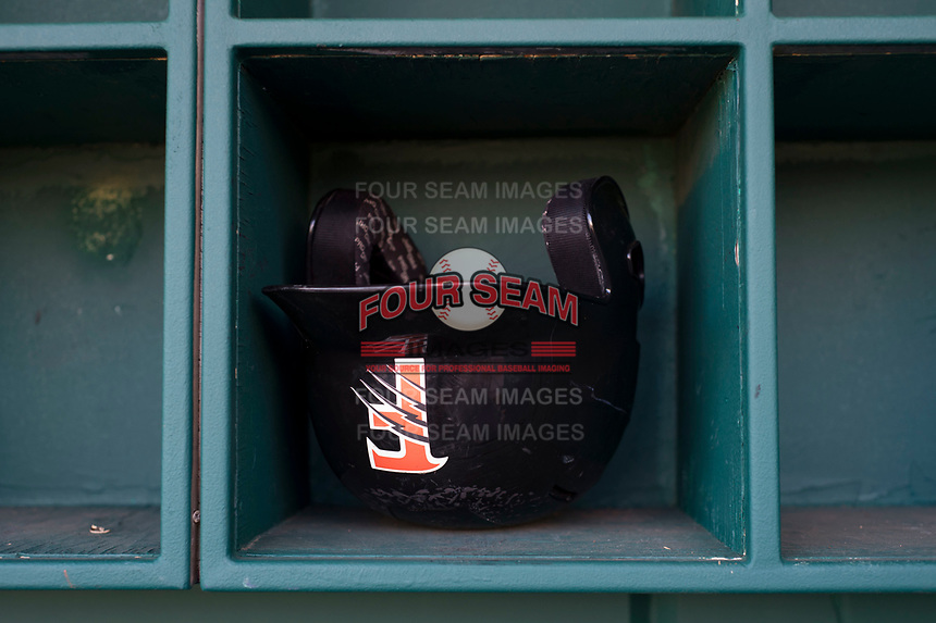 A Fresno Grizzlies batting helmet rests in the cubbies before a Pacific Coast League game against the Salt Lake Bees at Chukchansi Park on May 14, 2018 in Fresno, California. Fresno defeated Salt Lake 4-3. (Zachary Lucy/Four Seam Images)
