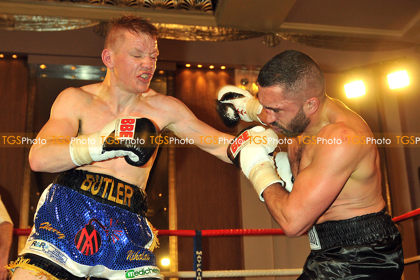 Matt Butler (black shorts) defeats Ali Wyatt - Boxing at the Park Lane Hotel, Mayfair - 05/02/15 - MANDATORY CREDIT: Philip Sharkey/TGSPHOTO - Self billing applies where appropriate - contact@tgsphoto.co.uk - NO UNPAID USE