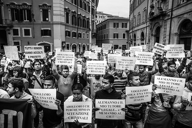 Documentary photos on the hundreds of families illegally seizing buldings as squatters due the growing economic crisis in Rome, Italy. This kind of problems in the past were led by inmigrants, but now Italians as well become squatters since housing problems are rampant.