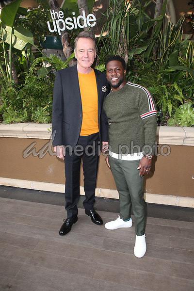 """30 October 2018 - Beverly Hills, California - Bryan Cranston, Kevin Hart. """"The Upside"""" Photo Call held at The Four Seasons Beverly Hills. Photo Credit: Faye Sadou/AdMedia"""