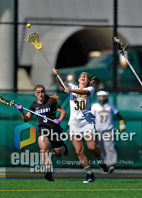 28 April 2012: University of Vermont Catamount defender Caitie Izzo, a Senior from Longmeadow, MA, in action against the University at Albany Great Dames at Virtue Field in Burlington, Vermont. The Lady Danes defeated the Lady Cats 12-10 in America East Women's Lacrosse. Mandatory Credit: Ed Wolfstein Photo