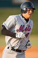 Wilmer Flores (4) of the Kingsport Mets rounds the bases following his solo home run in the top of the first inning versus the Johnson City Cardinals at Howard Johnson Field in Johnson City, TN, Thursday July 3, 2008.