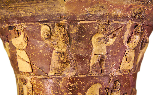 Hüseyindede vases, Old Hittite Polychrome Relief vessel, top frieze depicting a procession of musicians and dancers, , 16th century BC. . Çorum Archaeological Museum, Corum, Turkey. Against a white bacground.