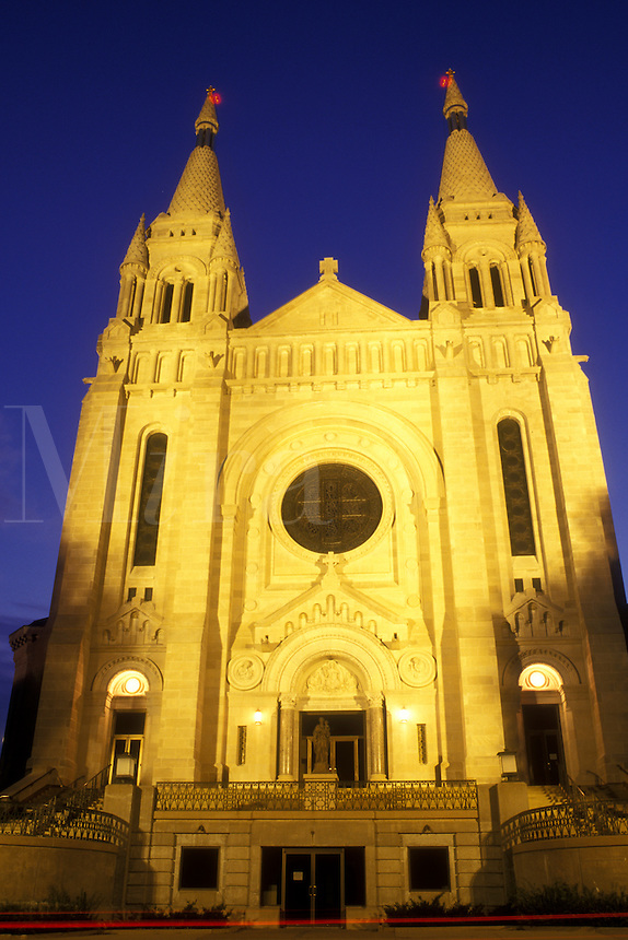 AJ0379, South Dakota, The facade of Saint Joseph's Cathedral is illuminated at night in Sioux Falls.French and German Romanesque Architecture.