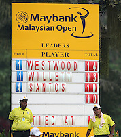Scoreboard showing Danny Willett (ENG) and Ricardo Santos (POR) chasing the leader Lee Westwood (ENG) during the Final Round of the 2014 Maybank Malaysian Open at the Kuala Lumpur Golf & Country Club, Kuala Lumpur, Malaysia. Picture:  David Lloyd / www.golffile.ie