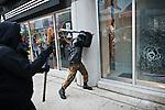 "© Hughes Léglise-Bataille/Wostok Press.Canada, Toronto .26.06.2010..Plusieurs milliers de personnes ont manifeste contre le sommet du G20 dans les rues de Toronto le jour de son ouverture. Un groupe de 200 a 300 manifestants (""black block"") s'est affronte avec la police, detruisant des vitrines dans tout le centre-ville et brulant 2 voitures de police. Plus de 150 personnes ont ete arretees...Thousands of people demonstrated against the G20 summit in the streets of Toronto on the day of its opening. A group of about 200 to 300 violent protesters (""black block"") confronted the police and smashed windows across the city center, burning down 2 police cars. More than 130 people have been arrested."