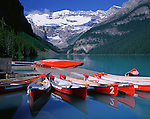 Banff National Park, Canada    <br /> Red canoes at the boat dock on Lake Louise with Mount Victoria and Victoria Glacier in the distance