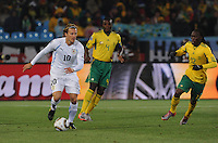 Midfielder Diego Forlan looks to enter the South African defensive third. For the match, Forlan scored a brace, one goal in each half. Uruguay defeated South Africa, 2-0, in both teams' second match of play in Group A of the 2010 FIFA World Cup. The match was played at Loftus Versfeld in Pretoria, South Africa June 16th.