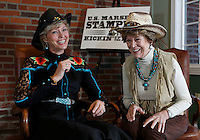 NWA Democrat-Gazette/DAVID GOTTSCHALK - 2/13/15 - Kathy Babb (left) and Mary Young discuss  Friday February 13, 2015 at the U.S. Marshals Office in Fort Smith the activities of the U.S. Marshals Stampede Kickin' up the Dust fundraising gala on March 14, 2015.