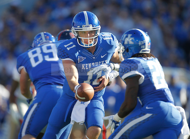 Kentucky Wildcats true freshman quarterback Maxwell Smith (11) hands the ball off during the first half of the University of Kentucky football game against Ole Miss at Commonwealth Stadium in Lexington, Ky., on 11/5/11. Uk led at half 10-6. Photo by Mike Weaver | Staff