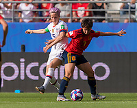 REIMS,  - JUNE 24: Megan Rapinoe #15 fights with Marta Corredera #7 during a game between NT v Spain and  at Stade Auguste Delaune on June 24, 2019 in Reims, France.