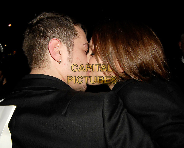 MATT WILLIS & EMMA GRIFFITHS .Leaving the ELLE Style Awards, The Roundhouse, Chalk Farm Road, London, UK. .February 12th 2007.headshot portrait black couple bad skin pimples acne profile kiss kissing.CAP/SW.©Stephen Walters/Capital Pictures