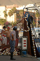 Fishermen loading nets onto Traditional Canarian fishing boat in harbour, Tenerife, Canary Islands Spain, Eastern Atlantic Ocean