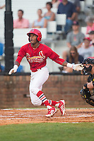 DeAndre Asbury-Heath (5) of the Johnson City Cardinals follows through on his swing against the Bristol Pirates at Howard Johnson Field at Cardinal Park on July 6, 2015 in Johnson City, Tennessee.  The Cardinals defeated the Pirates 8-2 in game two of a double-header. (Brian Westerholt/Four Seam Images)