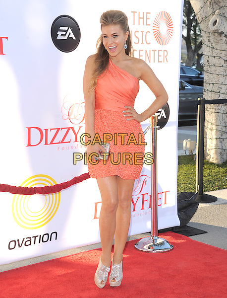 Carmen Electra.attends the Dizzy Feet Foundation's Celebration of Dance Gala held at The Dorothy Chandler Pavilion at The Music Center in Los Angeles, California, USA,  July 28th 2012..full length orange dress one shoulder gold silver shiny peep toe christian loubouin shoes shooboots platform clutch bag hand on hip                                                                .CAP/RKE/DVS.©DVS/RockinExposures/Capital Pictures.