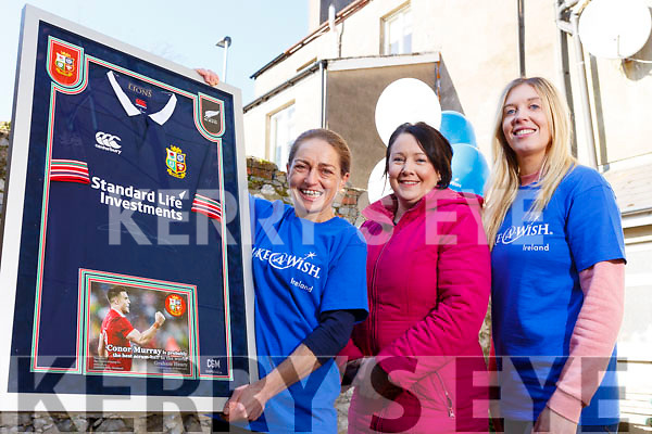 """Corinne Evans presents a signed jersey from Conor Murray's All Black tour to Therese Ahern and it will be raffled off with the proceeds going to """"The Make a Wish Foundation"""". From l to r: Corinne Evans, Therese Ahern and Laura Sheehy."""