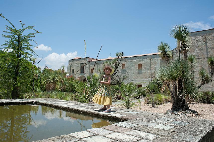 A girl enjoying the etno-botanical gardens. Santo Domingo,  Oaxaca City, Oaxaca, Mexico
