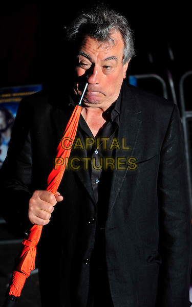 "TERRY JONES.The UK Premiere of ""The Imaginarium Of Doctor Parnassus"" at the Empire Leicester Square, London, England..October 6th 2009.half length black suit brown shirt orange umbrella holding sticking in nose funny .CAP/CJ.©Chris Joseph/Capital Pictures."