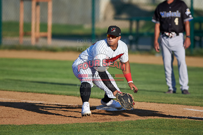 Great Falls Voyagers first baseman Harvin Mendoza (17) prepares to catch a low throw during a Pioneer League game against the Missoula Osprey at Centene Stadium at Legion Park on August 19, 2019 in Great Falls, Montana. Missoula defeated Great Falls 4-1 in the first game of a doubleheader. Games were moved from Missoula after Ogren Park at Allegiance Field, the Osprey's home field, was ruled unplayable. (Zachary Lucy/Four Seam Images)