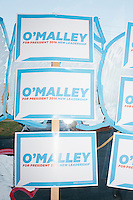 Campaign posters decorate the walls as Democratic presidential candidate and former governor of Maryland Martin O'Malley speaks to a small crowd at the kickoff of his New Hampshire campaign headquarters in Manchester, New Hampshire.