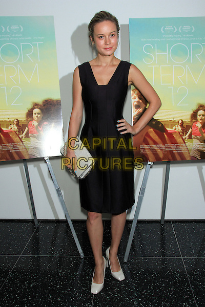 Brie Larson<br /> The New York Premiere of &quot;Short Term 12&quot; at the Museum of Modern Art (MoMA), New York, NY., USA.<br />  August 18th, 2013<br /> full length dress hand on hip white shoes clutch bag black sleeveless <br /> CAP/LNC/TOM<br /> &copy;TOM/LNC/Capital Pictures