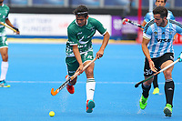Pakistan's Muhammad Rizwan Jnr in full flight marshalled by Agustin Bugallo of Argentina during the Hockey World League Quarter-Final match between Argentina and Pakistan at the Olympic Park, London, England on 22 June 2017. Photo by Steve McCarthy.