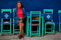 A Colombian woman sits in a coffee shop at the main plaza of Jardín, a village in the coffee region (Zona cafetera) of Colombia, 29 November 2016.
