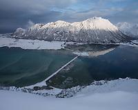 Fjordmannen mountain peak rises over Grunnførfjord, Delp, Austvågøy, Lofoten Islands, Norway