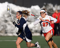Kara Moschetti (2) of Richmond sprints past Brittany Poist (27) of Maryland at the practice turf field in College Park, Maryland.  Maryland defeated Richmond, 17-7.