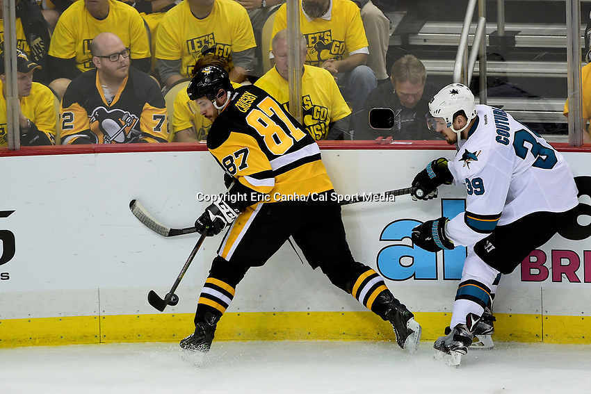 Monday, May 30, 2016: Pittsburgh Penguins center Sidney Crosby (87) battles San Jose Sharks center Logan Couture (39) to control the puck during game 1 of the NHL Stanley Cup Finals  between the San Jose Sharks and the Pittsburgh Penguins held at the CONSOL Energy Center in Pittsburgh Pennsylvania. The Penguins defeat the Sharks 3-2 in regulation time. Eric Canha/CSM