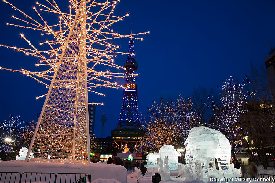 Sapporo, Japan<br /> Sapporo TV Tower stands above the annual Snow Festival in Odori Park, night scene with ice scupltures and lights