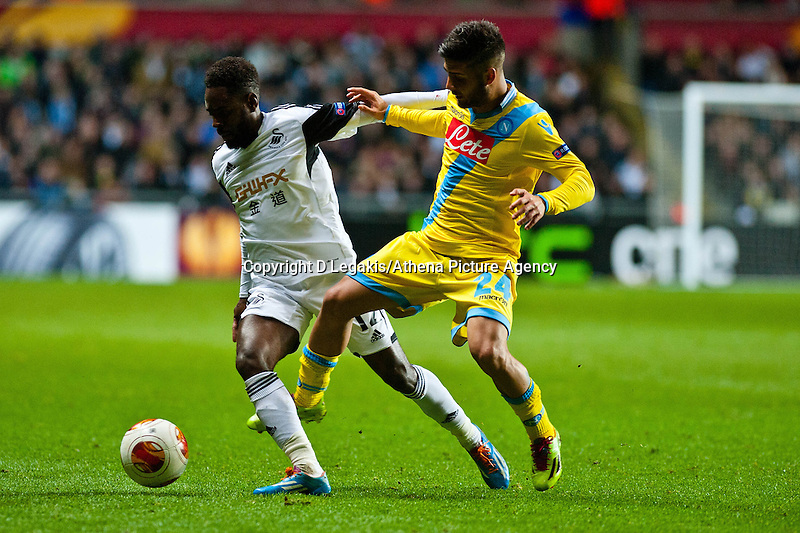 Swansea, UK. Thursday 20 February 2014<br /> Pictured: ( L-R ) Nathan Dyer is fouled by Lorenzo Insigne of Napoli<br /> Re: UEFA Europa League, Swansea City FC v SSC Napoli at the Liberty Stadium, south Wales, UK