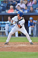 Asheville Tourists center fielder Eric Toole (14) squares to bunt during a game against the West Virginia Power at McCormick Field on May 10, 2017 in Asheville, North Carolina. The Tourists defeated the Power 4-3. (Tony Farlow/Four Seam Images)