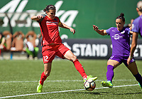Portland, OR - Saturday April 15, 2017: Christine Sinclair, Ali Krieger during a regular season National Women's Soccer League (NWSL) match between the Portland Thorns FC and the Orlando Pride at Providence Park.