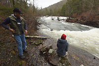 NWA Democrat-Gazette/FLIP PUTTHOFF<br />Gene Williams and Karen Mowry view the heavy flow      Feb. 23 2018     of Falling Water Creek after several inches of rain fell across the Ozark National Forest.