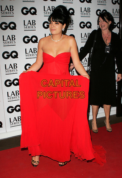 LILY ALLEN.Attending the 10th Anniversary GQ Men Of The Year Awards, Royal Opera House, Covent Garden, London, England, September 4th 2007..magazine full length long red maxi dress strapless gown lifting holding skirt leopard print shoes funny eyes blinking.CAP/AH.©Adam Houghton/Capital Pictures.