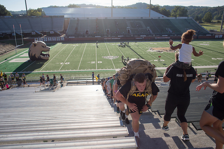 Some cadets of the Bobcat Battalion carried backpacks as they ran 2,071 steps with Athens residents and community members in Peden Stadium during the 9/11 Stair Challenge Event on Sept. 11, 2016. The stairs participants ran and walked symbolized the 2,071 stairs in one of the World Trade Center towers.