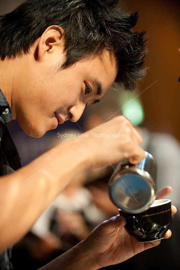MELBOURNE, AUSTRALIA - JANUARY 09: CHARLES SKADIANG competing in the 2011 Latte Art Championship held at St Kilda Town Hall on January 9, 2011 in Melbourne, Australia. (Photo by Sydney Low / Asterisk Images)