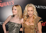 HOLLYWOOD, CA. - March 11: Actress Dakota Fanning and musician Cherie Currie arrive at the Los Angeles Premiere of The Runaways at ArcLight Cinemas Cinerama Dome on March 11, 2010 in Hollywood, California.