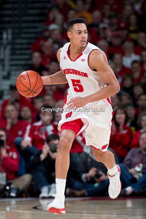 Wisconsin Badgers forward Ryan Evans (5) handles the ball during a Big Ten Conference NCAA college basketball game against the Michigan Wolverines Saturday, February 9, 2013, in Madison, Wis. The Badgers won 65-62 (OT). (Photo by David Stluka)