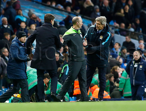 14.02.2016. The Etihad, Manchester, England. Barclays Premier League. Manchester City versus Tottenham Hotspur. Tottenham manager Mauricio Pochettino  shakes hands with Manchester City manager Manuel Pellegrini after the final whistle with 4th Official Mike Dean in the middle.