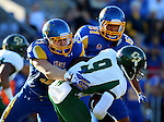 BROOKINGS, SD - SEPTEMBER 6:  TJ Lalley #33 and JT Hassell #51 from South Dakota State University combine for the tackle of Chris Brown #9 from Cal Poly in the first half of their game Saturday evening at Coughlin Alumni Stadium in Brookings.(Photo/Dave Eggen/Inertia)