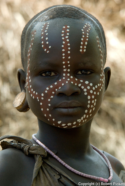 Young Girl with face painted, Mursi Tribe, Mago National Park, Lower Omo Valley, Ethiopia, portrait, person, one, tribes, tribal, indigenous, peoples, Southern, ethnic, rural, local, traditional, culture, primitive,.Africa....