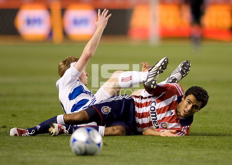 Chivas USA defender Jonathan Bornstein gets tangled up with FC Dallas midfielder Dax McCarty. The Chivas USA defeated FC Dallas 2-0 at Home Depot Center stadium in Carson, California on Saturday April 25, 2009.   .