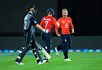 England's Matt Parkinson celebrates dismisisng New Zealand's Colin Munro with keeper Sam Billings (centre) during the 4th Twenty20 International cricket match between NZ Black Caps and England at McLean Park in Napier, New Zealand on Friday, 8 November 2019. Photo: Dave Lintott / lintottphoto.co.nz