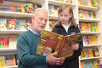 "*** NO FEE PIC***.01/03/2012.Pictured is Irish Author Brendan O' Brien with third class pupil Lucy Hand (9) from Holy Cross National School Dundrum, Dublin at a free reading event of his book "" The Story of Ireland"" in Eason Dundrum to celebrate the 15th annual World Book Day. To celebrate World Book Day Eason, Ireland's leading retailerof books, stationery, magazines & More have teamed up with some of Ireland'sleading children's writers to deliver a series of events in key stores to mark World Book Day..Photo: Gareth Chaney Collins"